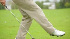 Golfer shows mastery of the club and ball Stock Footage