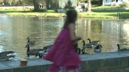 Stock Video Footage of Little girls feeding ducks (5 of 7)