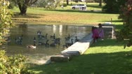 Stock Video Footage of Little girls feeding ducks (2 of 7)