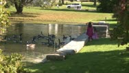 Stock Video Footage of Little girls feeding ducks (1 of 7)