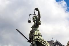 Stock Photo of statue of lady justice in front of the romer in frankfurt