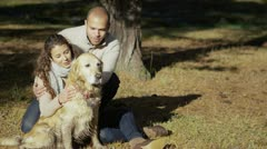 Portrait of an attractive couple and their dog in the forest Stock Footage