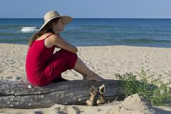 beautiful young woman relaxing on the beach - stock photo