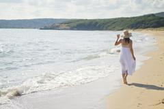 peaceful walk along the coast - stock photo