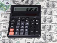 dollar, euro banknote and calculator - stock photo