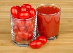 Tomato juice and tomato Stock Photos