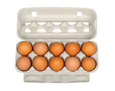 dozen eggs in carton - stock photo