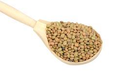 Lentils in wooden spoon Stock Photos
