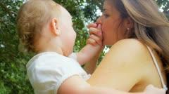 Caucasian mother embracing happy kid in garden Stock Footage
