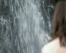 Stock Video Footage of woman and waterfall - soft focus - 720x576 Anmorphic
