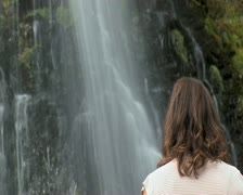 Stock Video Footage of girl waiting by waterfall - slow shutter