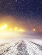 Winter road at night Stock Photos