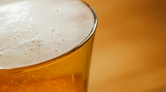 Overflowing glass of beer Stock Footage