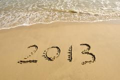 Number 2013 on the beach of sunrise Stock Photos