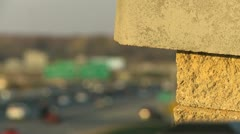 Traffic stone pillar rack focus Stock Footage