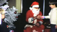 SANTA Claus GIVES PRESENTS Christmas Eve Day 1960s Vintage Film Home Movie 6361 Stock Footage