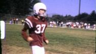 Stock Video Footage of PLAYER Jr. High School Football 1965 (Vintage Old Film Home Movie Footage) 6379