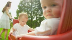 Caucasian parent pulling play trailer with toddlers Stock Footage