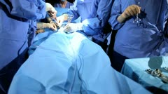 Specialized Team Performing Surgery in Operating Room Stock Footage