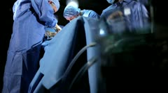 Multi Ethnic Surgical Team in Operating Theater Stock Footage