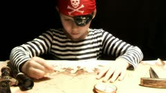 Child dressed as a pirate treasure map drawing Stock Footage