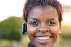 businesswoman with bluetooth headset - stock photo
