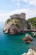 Dubrovnik scenic view on harbor fortification Stock Photos