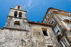 Decayed old church and houses, corfu city greece Stock Photos