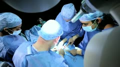 Overhead View Doctors in Hospital Operating Room Stock Footage