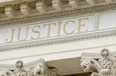 Justice word engraved Stock Photos