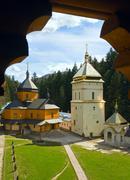 Christian monastery view through the wooden window Stock Photos