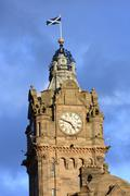 tower of the balmoral hotel before blue sky, edinburgh - stock photo