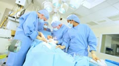 Doctors in Hospital Operating Room Stock Footage