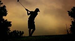 Silhouette golf swing left Stock Footage