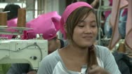 Asian Garment Industry Factory: Happy Female Garment Worker with Pink Scarf #1 Stock Footage