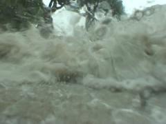 Hurricane wave smacks cameraman Stock Footage