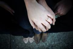 Engaged couple holding hands Stock Photos