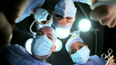 Multi Ethnic Surgical Team in Operating Theater Patient POV - stock footage