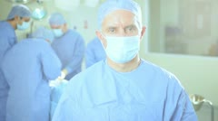 Doctor Portrait with Surgical Team Background Stock Footage