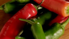 Red and green chillies CU - stock footage
