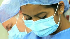 Surgical Team Working Hospital Operating Room Close Up - stock footage