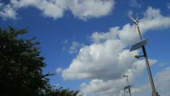 Stock Video Footage of Wind turbine against beautiful blue sky in park