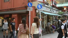 Tourists walking around Asakusa market Stock Footage