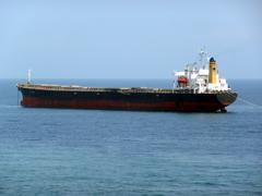 Cargo ship at anchor Stock Photos