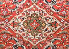 red old-fashioned wall carpet in asian style - stock photo