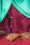 Room with a hookah and pile of pillows Stock Photos