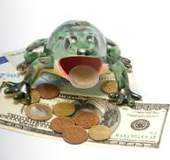 Ceramic frog and money. Stock Photos