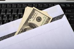 Money and notebook. Stock Photos