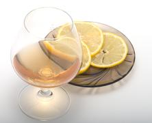 Cognac and lemon. Stock Photos