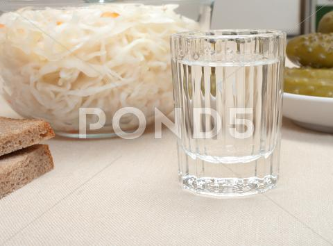 Stock photo of vodka and snack.